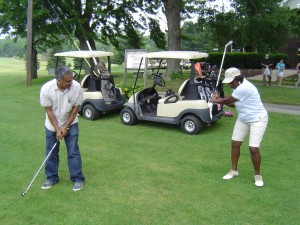 Renee Powell helps Bernardo perfect his golf swing!