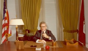 Ernest L. Boyer sitting at his desk at his welcoming party to Washington, DC as the new Commissioner of Education, 1977 (BCA)