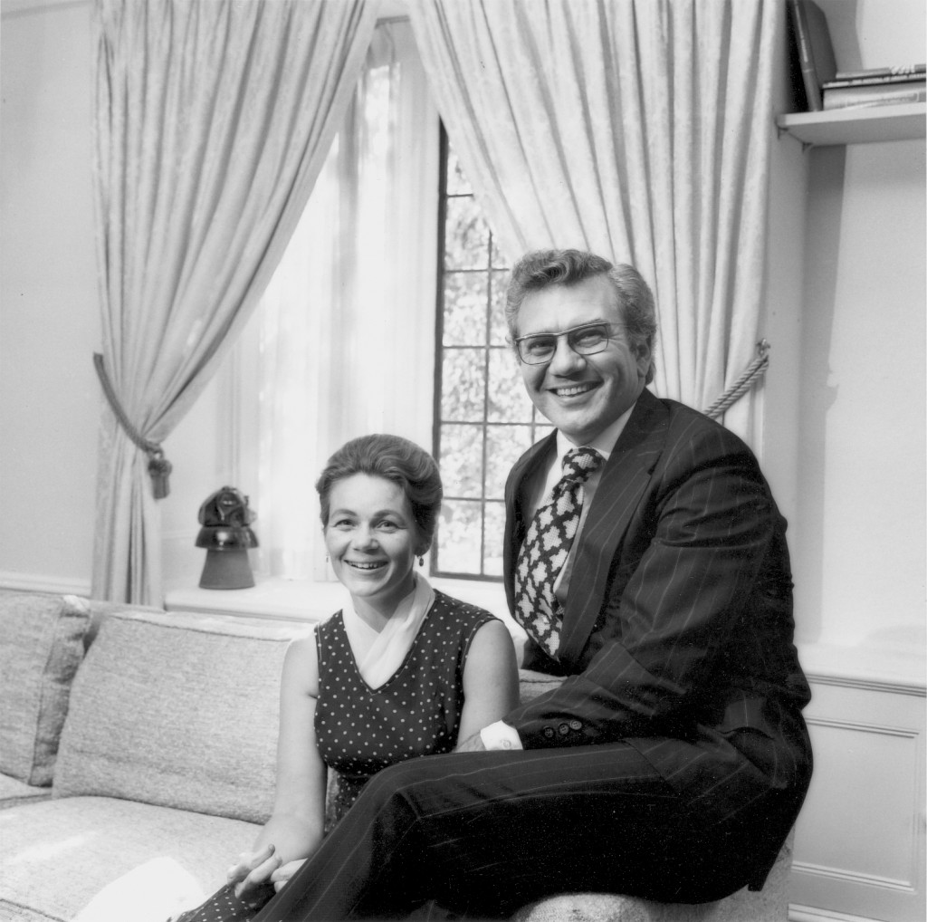 Black and white photo of Ernest L. and Kay Boyer sitting in the living room of the SUNY chancellor's home in Albany. - BCA
