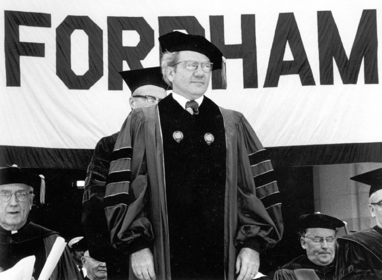 Black and white photograph of Ernest L. Boyer receiving an honorary degree from Fordham University. - BCA