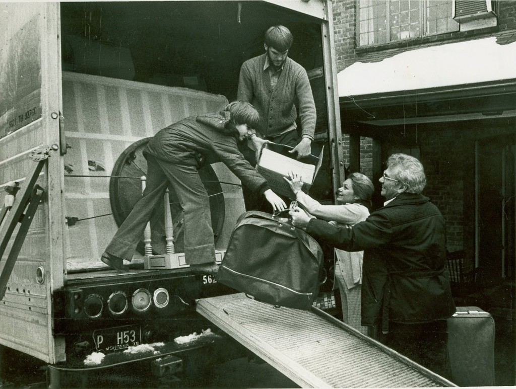 The Boyer family (Ernest L., Kay, Craig, and Stephen) packing a moving truck and preparing for their move from Albany, New York to Washington, D.C., so Ernest L. Boyer can take over as the United States Commissioner of Education. - BCA