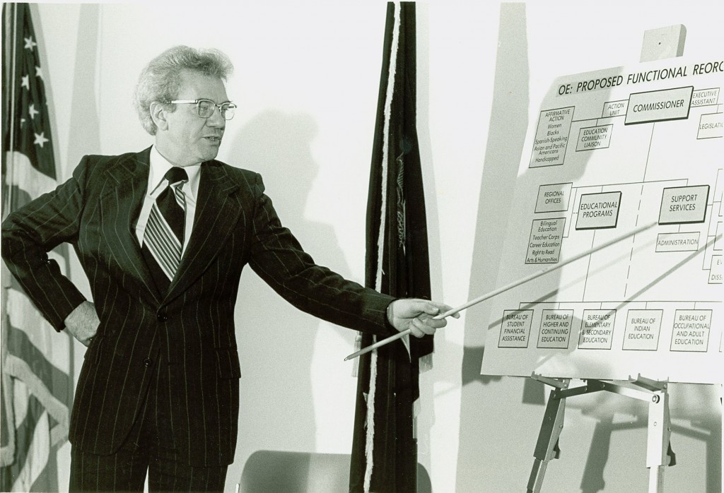 Ernest L. Boyer uses a pointer to explain a chart about new educational strategies for the federal government.