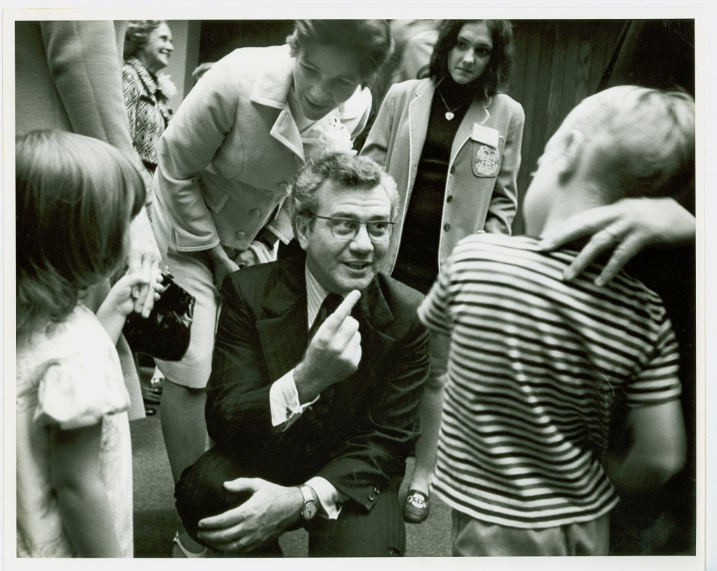 Ernest and Kathryn Boyer speaking to two children while Boyer served as Chancellor of the State University of New York