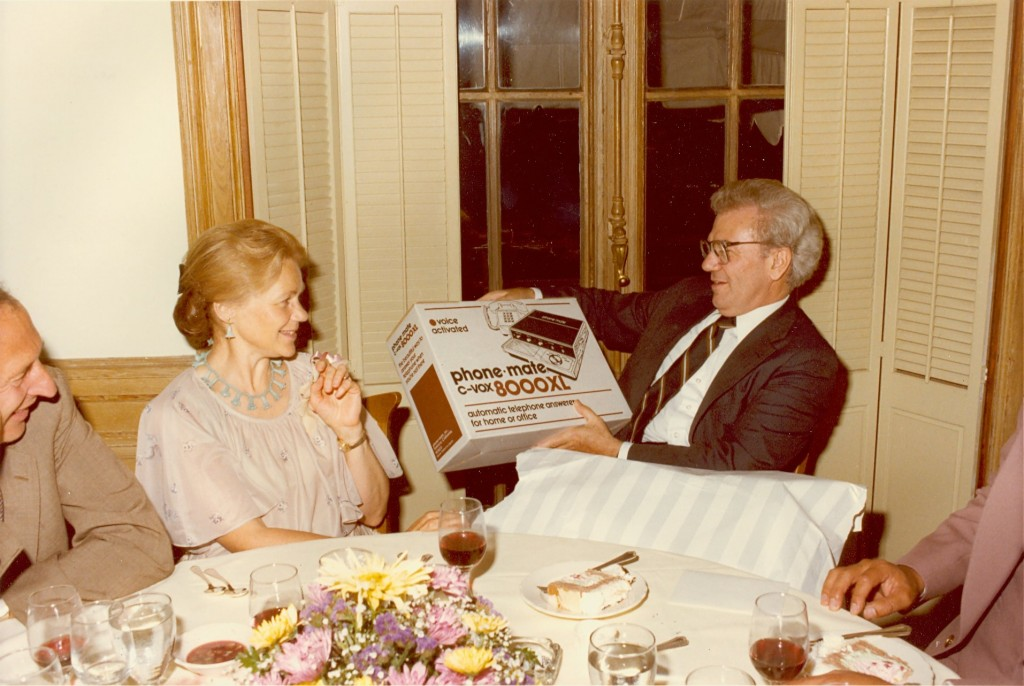 "Ernest L. and Kay Boyer opening a gift at a ""Dinner with the Deputies"" event in Washington, DC. - BCA"