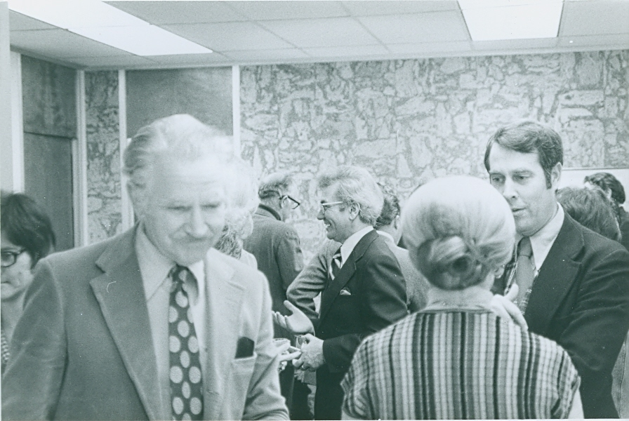 Ernest L. Boyer mingling with employees of the central administration of SUNY in Albany, New York. -BCA