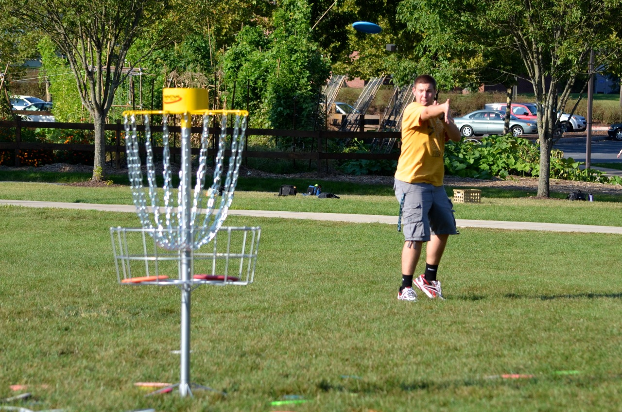 A Messiah College student plays disc golf.